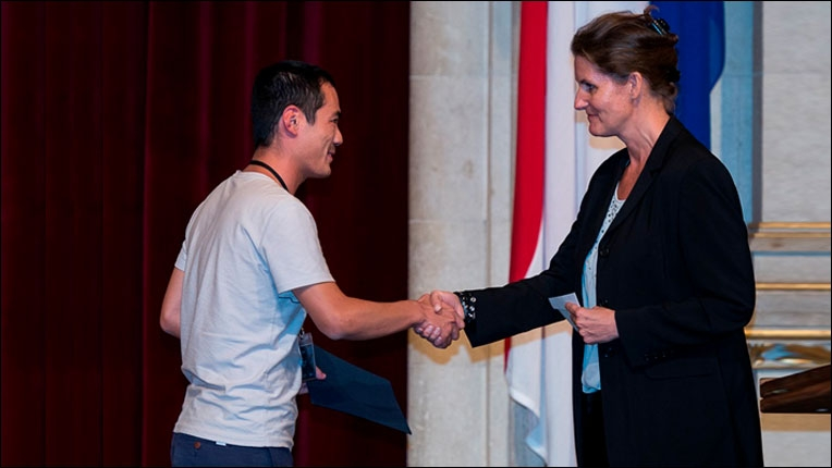 ACM Europe Council / ACM-W Europe Executive Committee member Gabriele Anderst-Kotsis congratulating Best Student Paper Award co-recipient Xiao Han.